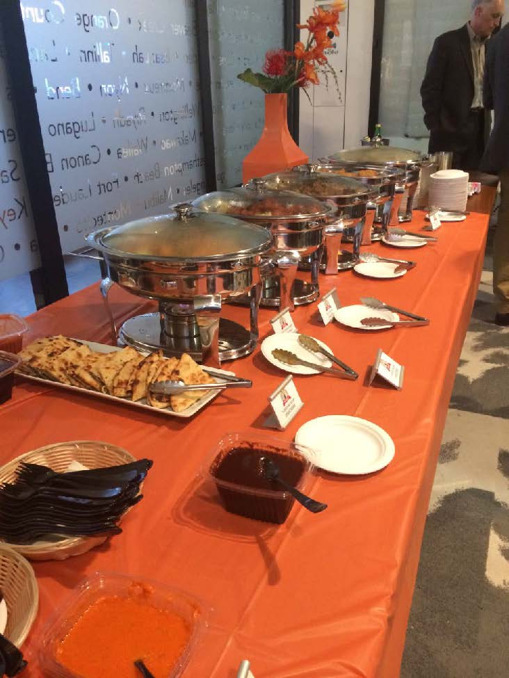 PICTURED ABOVE: In addition to wine tastings provided by DeLille Cellars, guests were treated to a buffet of fine Indian cuisine.