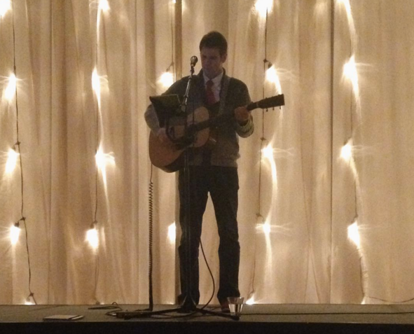 Above: Mycle Wastman Serenades Guests with an Acoustic Christmas Tune Set