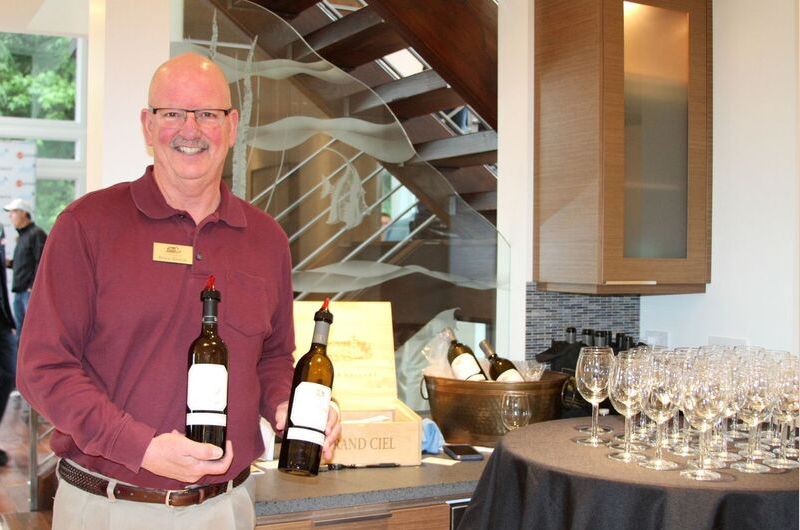 Above: Representatives of DeLille Cellars were all smiles as they served tastings of their award-winning wines during the LOL event.