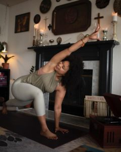 Jasmine RaShae' moves through a yoga flow.